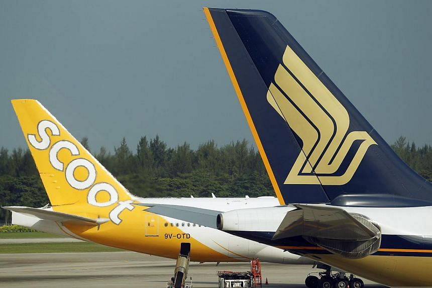 Singapore Airlines (SIA) frequent flyers can use their miles to redeem flights on Scoot and Tigerair from April. KrisFlyer members will also be able to collect miles when flying on the two other carriers starting later this year. -- ST PHOTO:LI