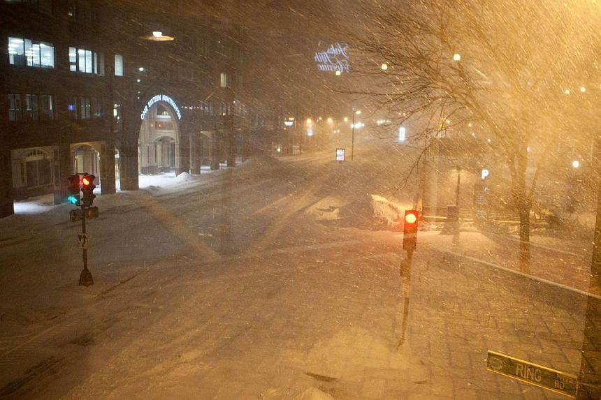 Snow falls heavily during a blizzard on Jan 27, 2015, in Boston, Massachusetts. -- PHOTO: AFP