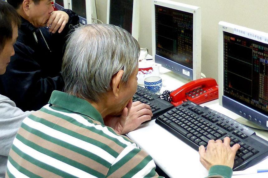 Investors checking share price data at a stock brokerage in Taipei, Taiwan, on Jan 26, 2015. Asian shares moved higher on Tuesday and the euro clung to rare gains, relieved that European markets had weathered Greece's election outcome without much di