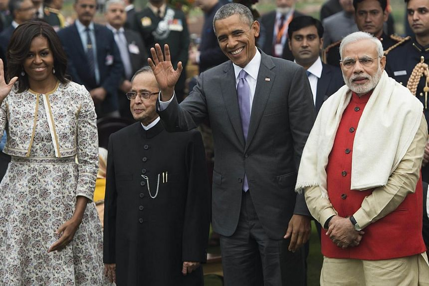 (From left) US First Lady Michelle Obama, Indian President Pranab Mukherjee, US President Barack Obama and Indian Prime Minister Narendra Modi at a reception at Rashtrapati Bhawan, the presidential palace, in New Delhi on Jan 26, 2015. -- PHOTO: AFP
