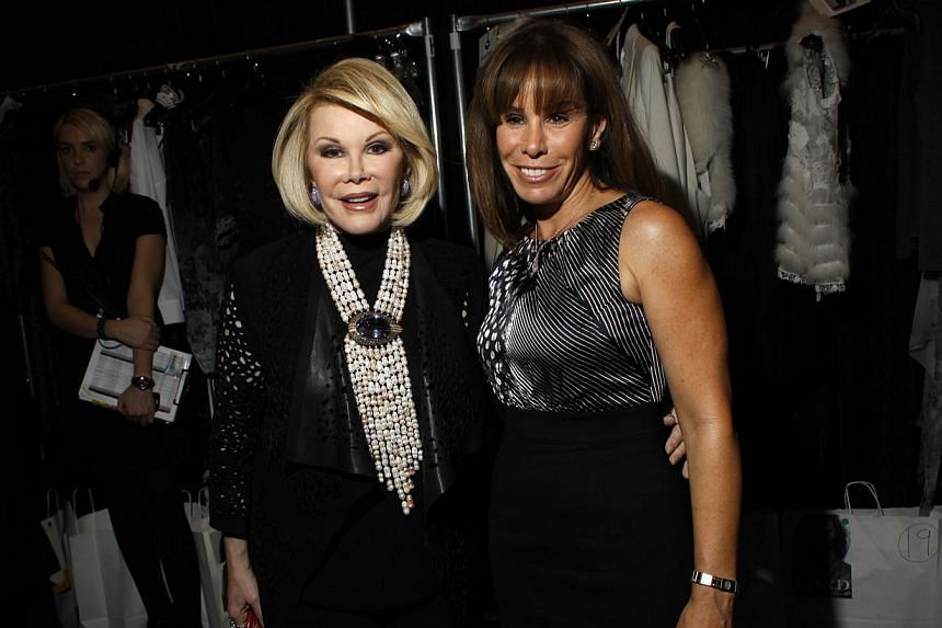 Comedienne Joan Rivers (left) and her daughter, TV personality Melissa Rivers, attending the Elie Tahari Fall/Winter 2011 collection show during New York Fashion Week in this file photo taken Feb 16, 2011. -- PHOTO: REUTERS