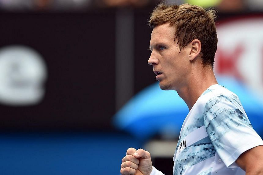 Tomas Berdych played arguably the grand slam quarter-final of his life to end the longest losing streak on the ATP Tour with a 6-2 6-0 7-6(5) victory over Rafa Nadal. -- PHOTO: EPA