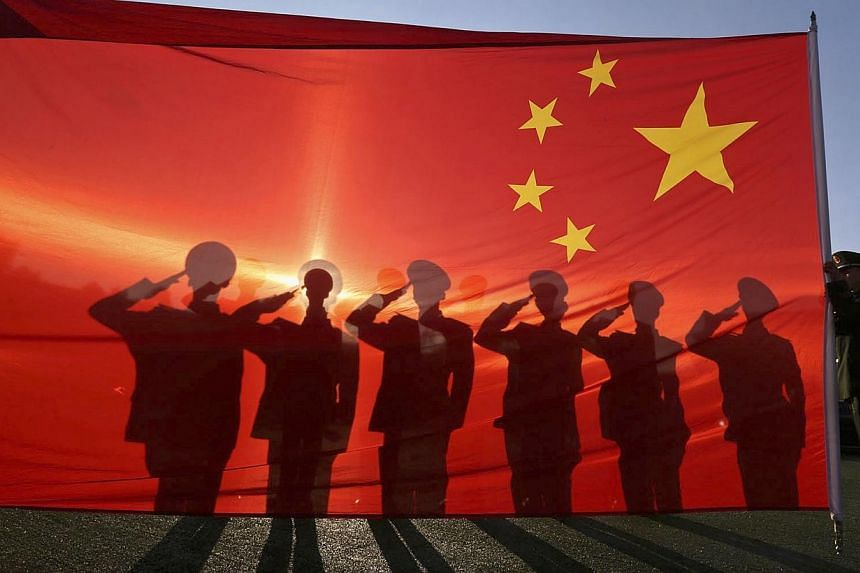 """China will this year hold its first large-scale military parade since 2009, reports said on Tuesday, with one key goal described as being to """"frighten Japan"""". -- PHOTO: REUTERS"""