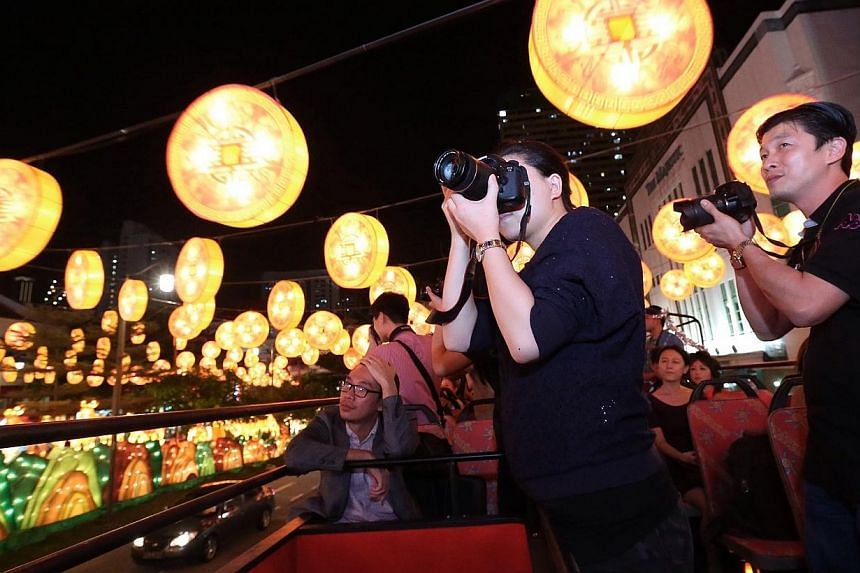 Members of the media on the tour of the Chinatown light-up taking photographs of the gold coin lanterns as part of the visual display. Chinatown will come alight this Saturday with 338 goat-shaped lanterns in anticipation of the Chinese New Year