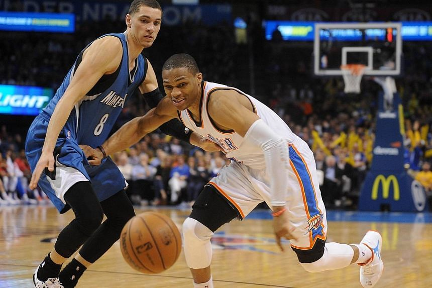 Oklahoma City Thunder guard Russell Westbrook (right) battles for the ball with Minnesota Timberwolves guard Zach LaVine (8) during the fourth quarter at Chesapeake Energy Arena. Westbrook and the Thunder easily defeated the Timberwolves 92-84 on Tue