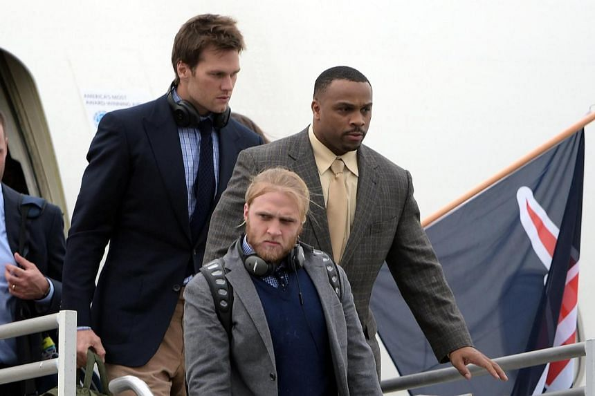 New England Patriots quarterback Tom Brady (second from right) arriving at Sky Harbor Airport in preparation for Super Bowl XLIX against the Seattle Seahawks.The Patriots escaped a winter blizzard to make their way to the Super Bowl city of Pho