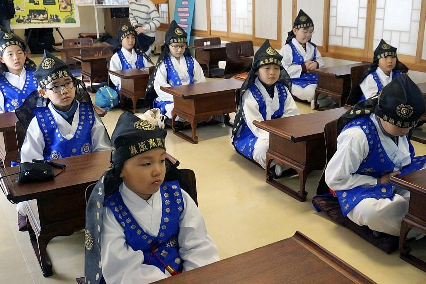 Children attend class at a 'Seodang', or traditional Korean school, in Seoul, South Korea, on Jan 13 2015.The government vowed on Tuesday to introduce a national qualification examination for workers at daycare centres for children amid rising