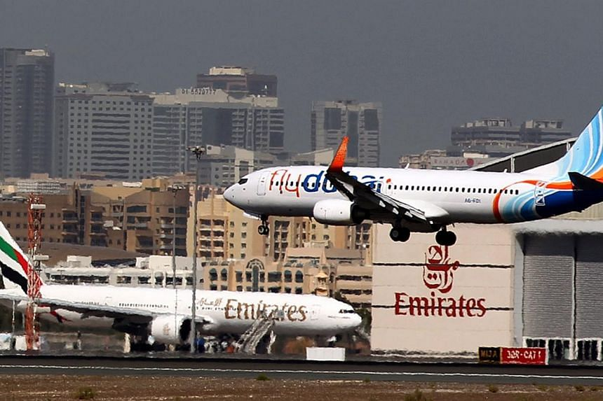 A bullet hit the fuselage of a flydubai airliner on its descent into Baghdad, lightly wounding a young girl and prompting many carriers on Tuesday to suspend their flights, officials said. -- PHOTO: AFP