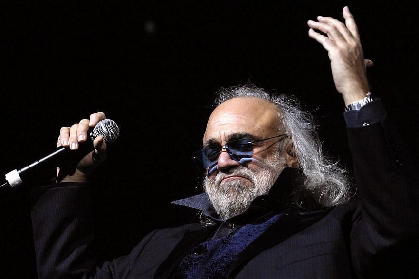 A file picture taken on Dec 15, 2006 in Paris, shows Greek singer Demis Roussos performing on the stage of the Zenith music hall. Roussos died during the weekend of Jan 24 and 25, 2015 in Athens, according to the sources at the hospital.-- PHOT
