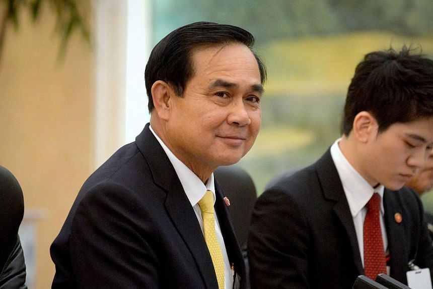 Thailand's Prime Minister Prayuth Chan-ocha (centre) listens as he meets with China's President Xi Jinping (not pictured) at the Great Hall of the People in Beijing on Dec 23, 2014. -- PHOTO:REUTERS