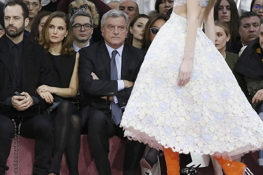 Actress Natalie Portman (second from left), her husband Benjamin Millepied and Christian Dior chief executive Sidney Toledano (right) attend at the fashion house's haute couture spring-summer 2015 fashion show on Jan 26, 2015. -- PHOTO: REUTERS