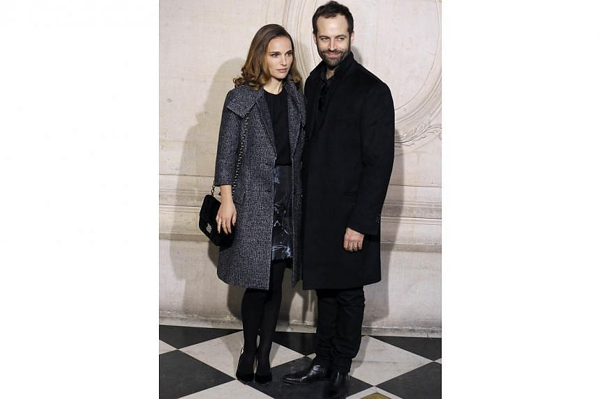 US actress Natalie Portman and her husband French dancer and choreographer, Benjamin Millepied, posing before attending the Christian Dior 2015 haute couture spring-summer collection fashion show. -- PHOTO: AFP