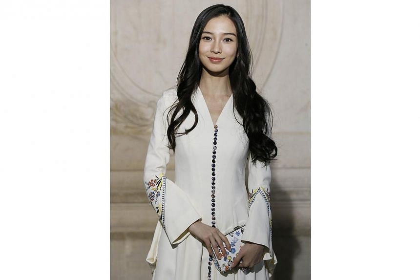 Chinese model and actress Angelababy poses prior to attend Christian Dior 2015 Haute Couture Spring-Summer collection fashion show in Paris on Jan 26, 2015. -- PHOTO: AFP