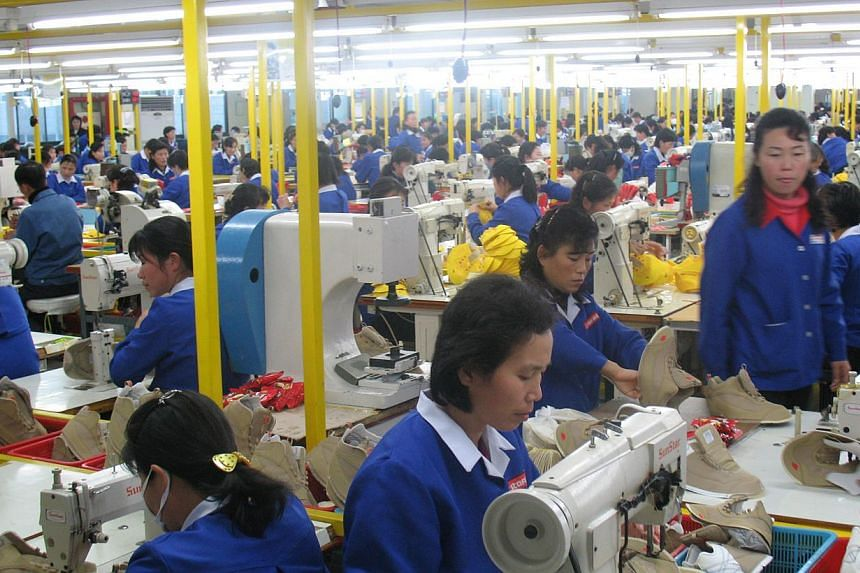 The Kaesong complex, which lies about 10 km inside North Korea, hosts some 100 Seoul-owned factories where 53,000 North Korean workers produce goods from clothes to watches. -- PHOTO: ANDREW SALMON