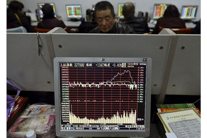 Investors looking at computer screens showing stock information at a brokerage house in Hangzhou, Zhejiang province, on Jan 9, 2015..After a two-day decline spurred by regulatory efforts on Jan 16 to curb margin lending by some of China's bigge