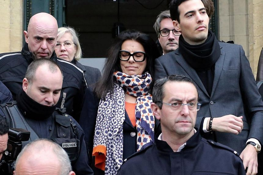Ms Francoise Bettencourt Meyers, daughter of France's richest woman, L'Oreal heiress Liliane Bettencourt, and her son, Jean-Victor (with black scarf), leaving the court with the family lawyers on Jan 26, 2015. -- PHOTO: AFP