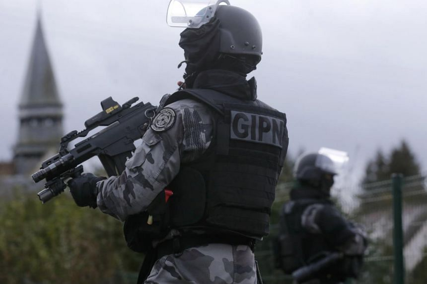 Four men were arrested on Tuesday by France's GIPN police special forces in the southern French town of Lunel, in an action aimed at breaking up extremist networks, a police source said. -- PHOTO: REUTERS