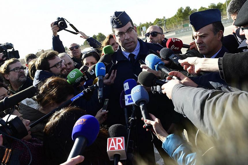 Captain Jose Guerreira speaks to the press outside the entrance to Los Llanos military base in Albacete on Jan 27, 2015, after a Greek fighter jet crashed on takeoff at the military base housing a Nato training centre for elite pilots. -- PHOTO: AFP