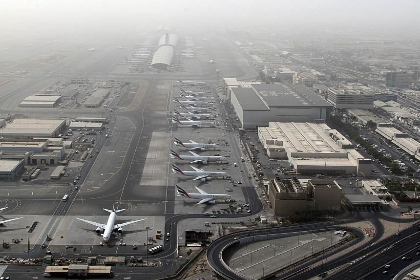 A file picture taken on May 27, 2012, an aerial view shows Dubai international airport, home to the national carrier Emirates Airways. -- PHOTO: AFP