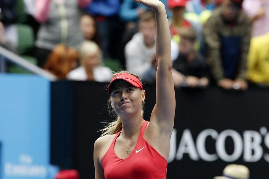 Maria Sharapova after winning against Eugenie Bouchard in their quarter-final match at the Australian Open in Melbourne on Jan 27, 2015. -- PHOTO: EPA