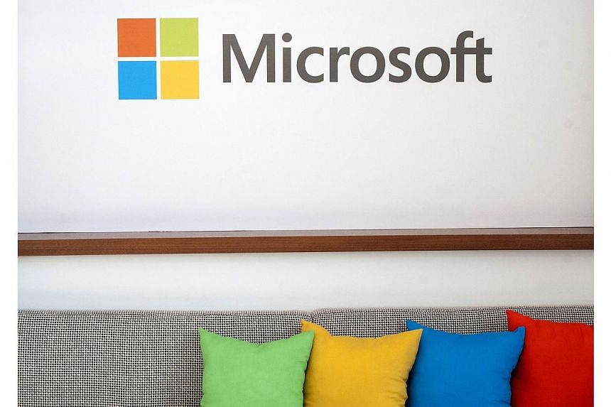 Microsoft Corp expects its fiscal third-quarter revenue growth to be cut by 4 per cent by unfavourable currency exchange rates. -- PHOTO: AFP