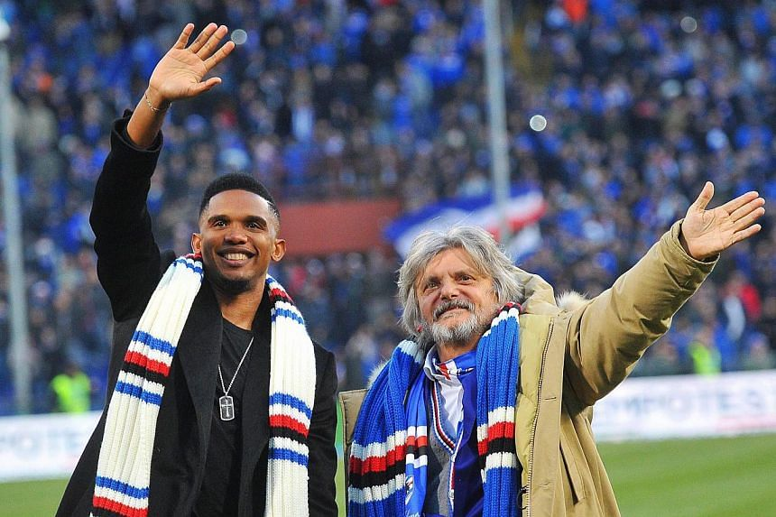 UC Sampdoria's President Massimo Ferrero (right) and forward Samuel Eto'o (left) greet fans after the Italian Serie A soccer match between UC Sampdoria and US Palermo at Luigi Ferraris stadium in Genoa, Italy on Jan 25, 2015. -- PHOTO: EPA