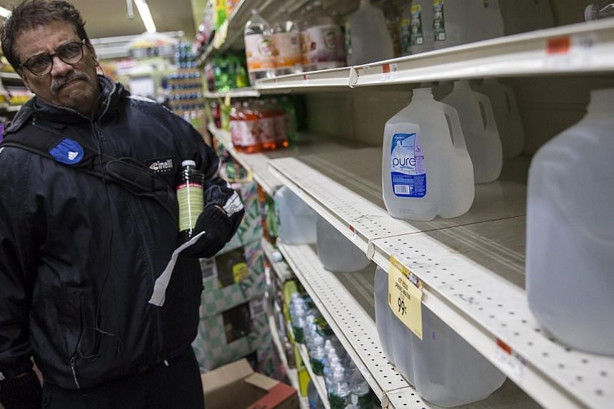 A man shopping for water in preparation for a large winter storm in New York, New York on Jan 26, 2015. -- PHOTO: EPA