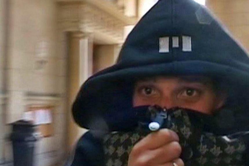 A man identified by a lawyer as Cherif Kouachi, one of the two brothers who killed 12 people in the attack on the weekly paper Charlie Hebdo in Paris, is seen in this still image taken from Reuters TV video shot in March 2008 at a Paris courthouse wh