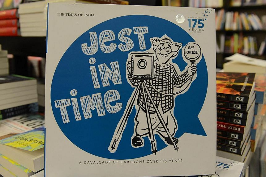 A copy of the book Jest In Time with a caricature of eminent Indian cartoonist R.K. Laxman on the cover page is pictured at a book shop in Ahmedabad on Monday, the day he died at age 93. -- PHOTO: AFP
