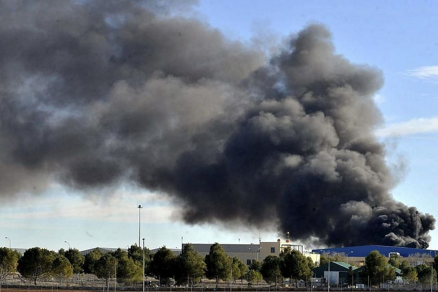 Smoke rising after a Greek F-16 aircraft crashed at Los Llanos air base in Albacete, eastern Spain, on Monday. -- PHOTO: EPA