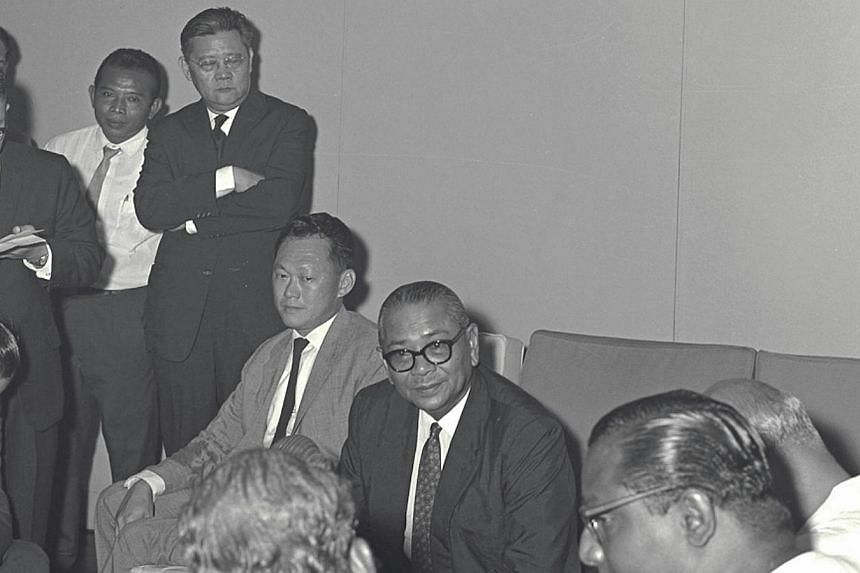 Tengku Abdul Rahman (seated, centre) giving a press conference on talks on Malaysia in 1962. Singapore's then prime minister Lee Kuan Yew is seated on the left. -- PHOTO: ST FILE