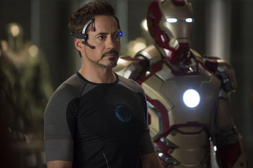 A cinema still from Marvel's Iron Man 3, starring Robert Downey Jr as Tony Stark, who designs his armour by creating a virtual blueprint on his computer which he manipulates by projecting it in real-time display. -- PHOTO: WALT DISNEY CO