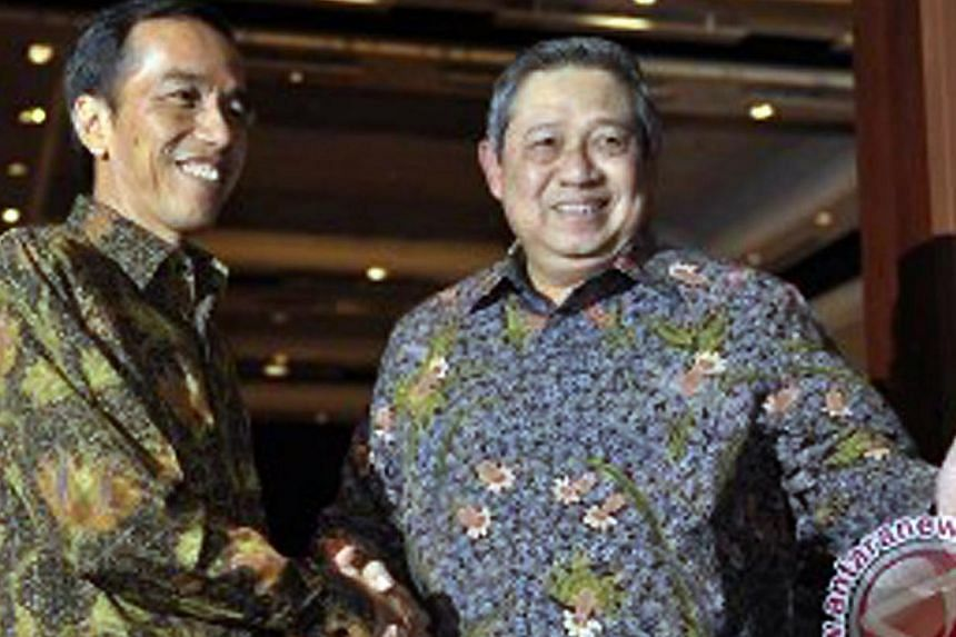 Indonesian President Joko Widodo (left) shaking hands with then outgoing president Bambang Susilo Yudhoyono on Sept 3, 2014. Dr Yudhoyono and other critics say that Mr Joko has yet to enact tough policies on law enforcement, corruption and bureaucrat