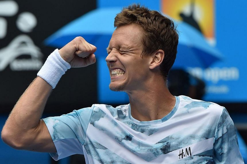 Czech Republic's Tomas Berdych celebrating after beating Spain's Rafael Nadal at the 2015 Australian Open in Melbourne on Jan 27, 2015. -- PHOTO: AFP