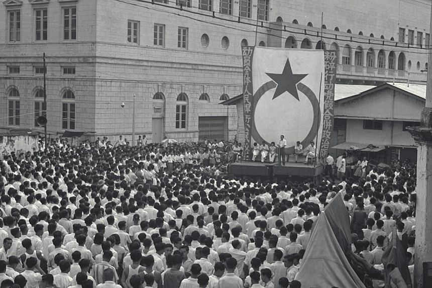 A Barisan Socialis rally held at Colombo Court on Dec 10, 1961. The Barisan Socialis was formed when 13 People's Action Party assemblymen were expelled from the party and went on to form their own political party in 1961. -- PHOTO: ST FILE