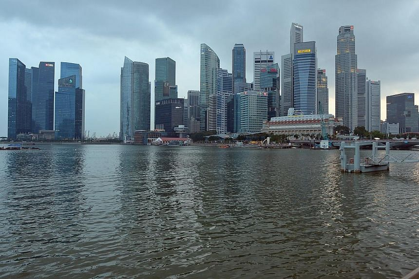 The Monetary Authority of Singapore announced on Wednesday a surprise adjustment to its monetary policy to slow the appreciation of the Singapore dollar.  -- PHOTO: ST FILE
