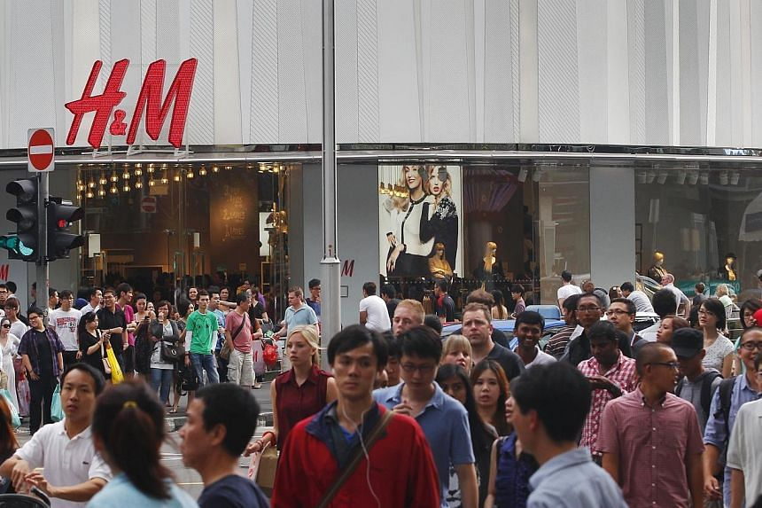 Swedish fashion giant H&M said on Wednesday net profits for 2014 rose almost a fifth and pledged to speed up its global expansion. -- PHOTO: ST FILE