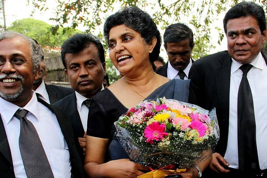 Sri Lanka's former chief justice Shirani Bandaranayake (centre) is greeted by lawyers at the Supreme Court complex in Colombo on Jan 28, 2015, after new Sri Lankan President Maithripala Sirisena reinstated her, saying that her controversial sacking b