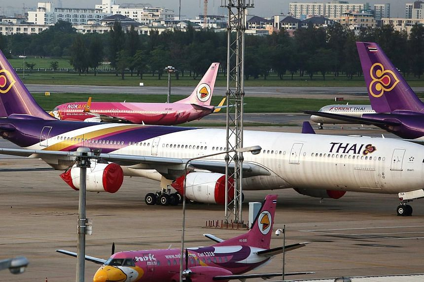 Thai Airways will reduce its workforce by around 5,000, or around 20 percent, over several years through attrition, the Bangkok Post newspaper reported on Wednesday, citing the transport minister.-- PHOTO:BLOOMBERG