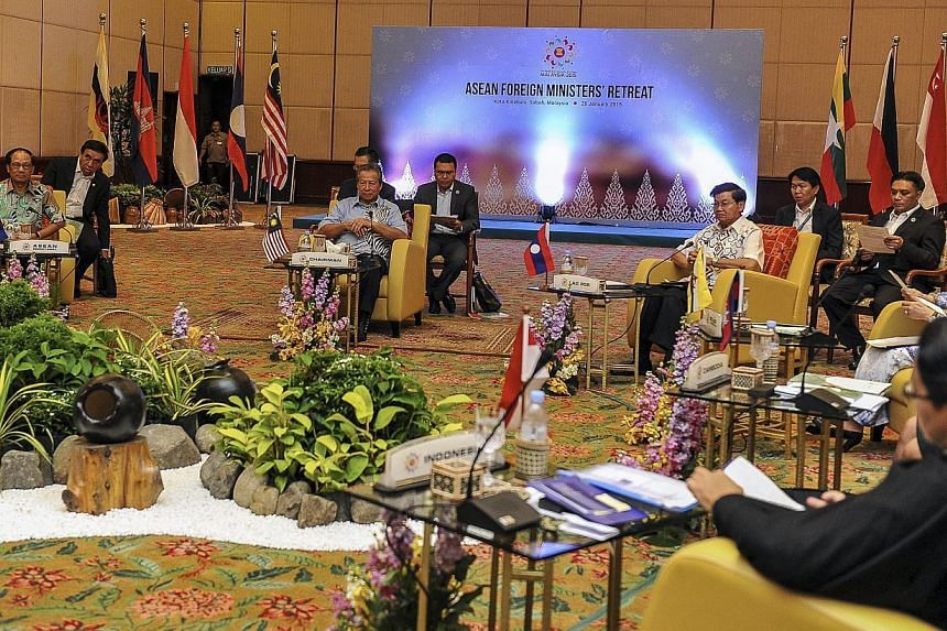 Malaysia Foreign Minister Anifah Aman (centre) speaks to ASEAN Foreign Ministers and delegates during ASEAN Foreign Ministers Retreat in Kota Kinabalu, Malaysia, Jan 28, 2015. Asean foreign ministers have condemned the violence and brutality committe