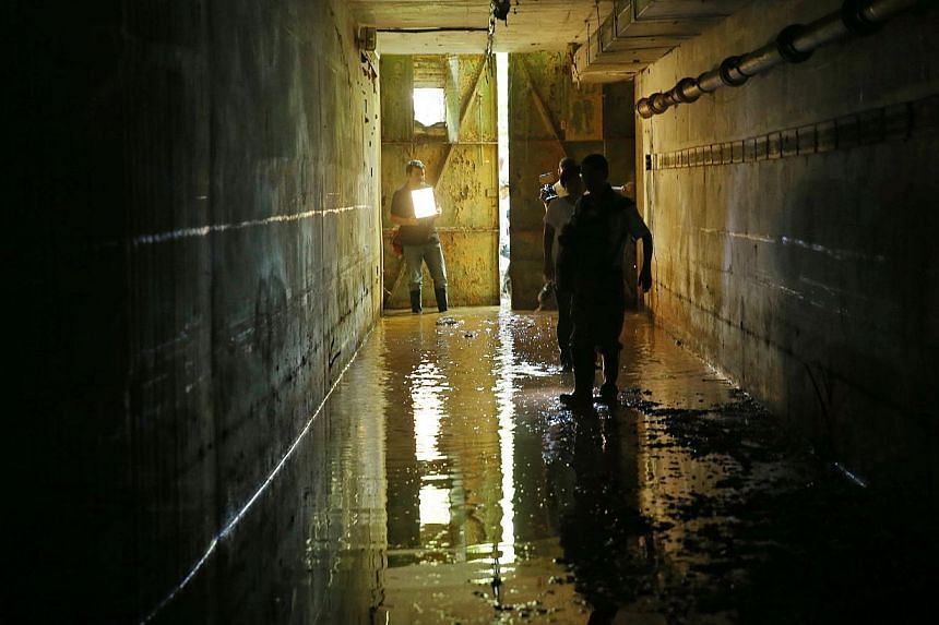 The mud-filled tunnel that leads to the bunker. -- ST PHOTO: SEAH KWANG PENG