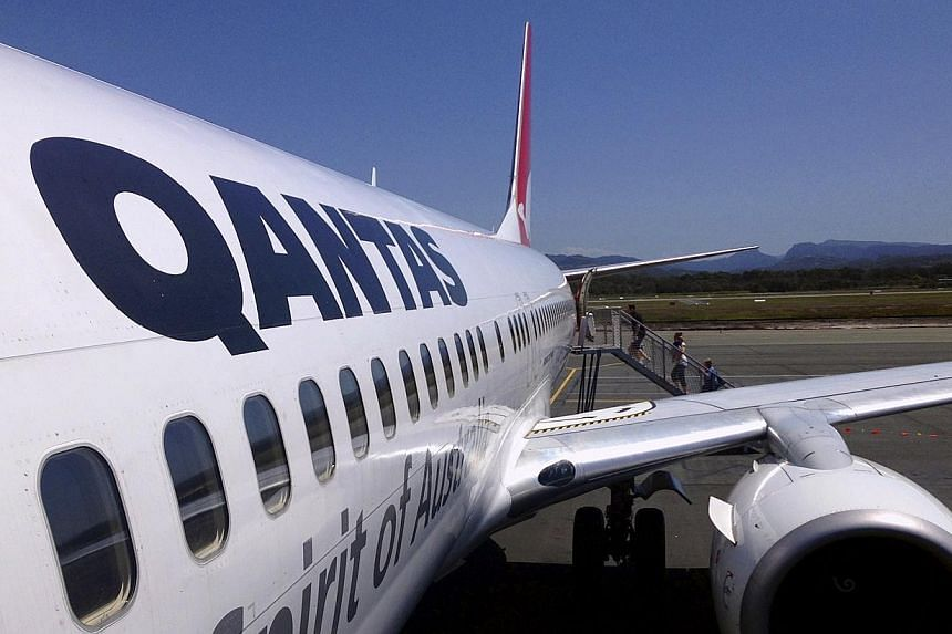 Australia's Qantas Airways became the latest airline to eliminate fuel surcharge on Tuesday. -- PHOTO: REUTERS