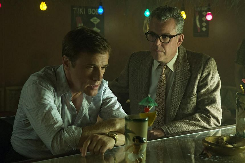 Christoph Waltz (far left, with Danny Huston) dials up the showmanship and vulnerability that add to the charm of his character in Big Eyes.