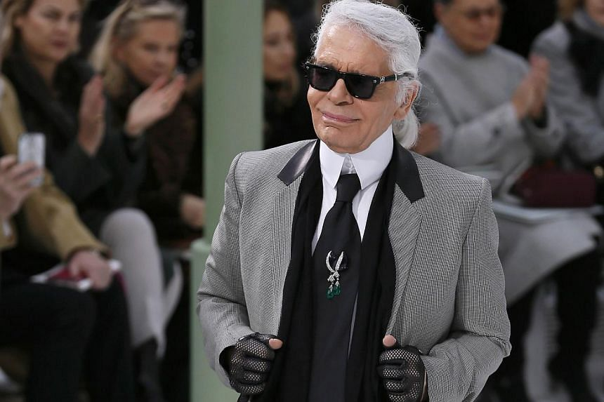 German fashion designer Karl Lagerfeld acknowledges the public at the end of the Chanel 2015 Haute Couture Spring-Summer collection fashion show on Jan 27, 2015 at the Grand Palais in Paris. -- PHOTO: AFP
