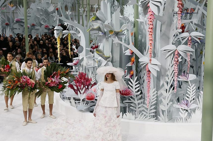 A model presents a creation from the Spring/Summer 2015 Haute Couture collection by German designer Karl Lagerfeld for Chanel during the Paris Fashion Week, in Paris, France, on Jan 27, 2015. -- PHOTO: EPA