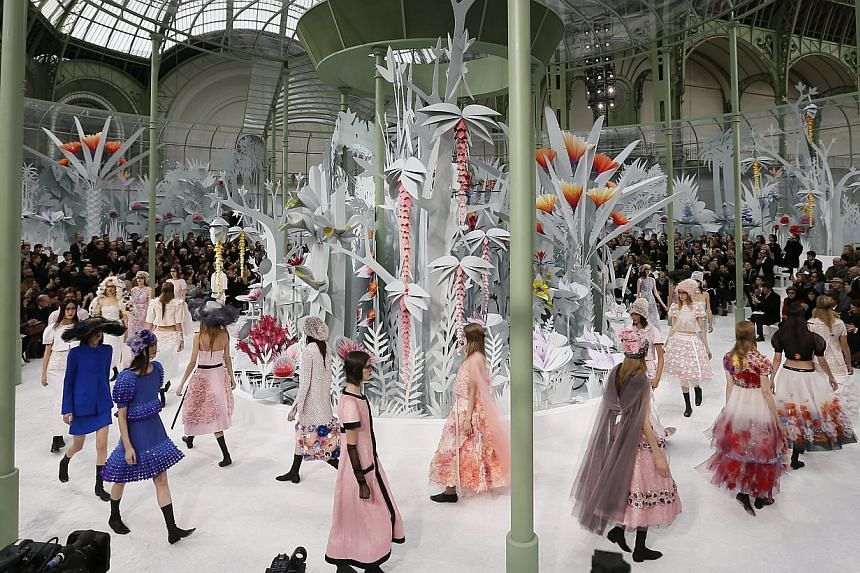 Models present creations from the Spring/Summer 2015 Haute Couture collection by German designer Karl Lagerfeld for Chanel during the Paris Fashion Week, in Paris, France, on Jan 27, 2015. -- PHOTO: EPA