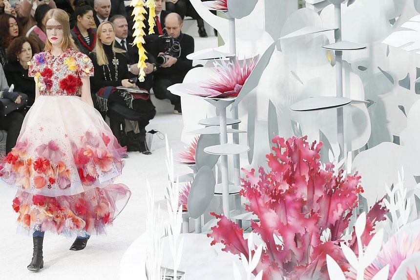 A model presents a creation by German designer Karl Lagerfeld as part of his Haute Couture Spring Summer 2015 fashion show for French fashion house Chanel in Paris on Jan 27, 2015. -- PHOTO: REUTERS
