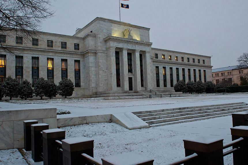 The US Federal Reserve building in Washington, DC on on Jan 27, 2015. The Fed begins its first monetary policy meeting of the year to take the pulse of the US economy as it mulls an interest rate hike. -- PHOTO: AFP