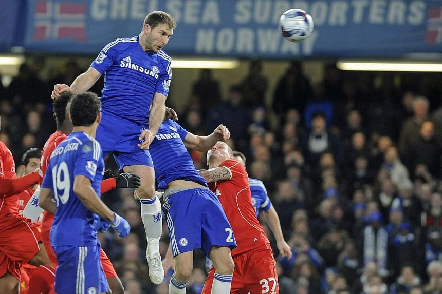 Chelsea's Branislav Ivanovic scoring the 1-0 in extra time during the English Capital One Cup semi-final football match return leg between Chelsea FC and Liverpool FC at Stamford Bridge in London, Britain, on Jan 27, 2015. -- PHOTO: EPA