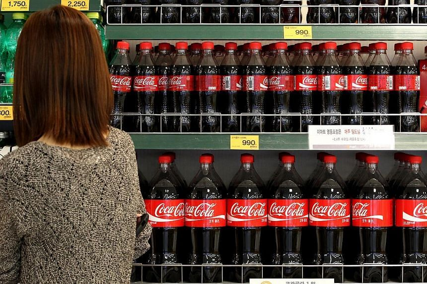 Girls who consume lots of sugary drinks start menstruating at a younger age, a study published in the journal Human Reproduction said on Wednesday, Jan 28, 2015. -- PHOTO: BLOOMBERG